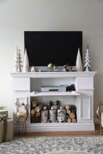 white faux fireplace mantle with storage