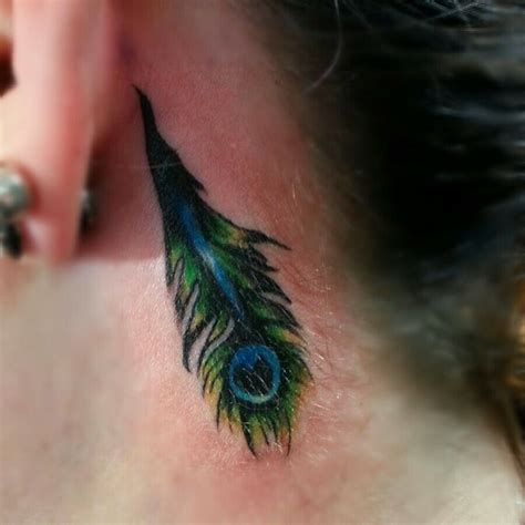 feather tattoo ear meaning feather tattoos behind ear meaning www imgkid com the