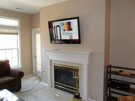 Installing Tv Wall Mount Fireplace by Living Room Fireplace Tv Wall Mounting Installation 2 Leslievillegeek Tv Installation Home