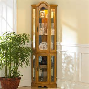 Ideas Design For Lighted Curio Cabinet Southern Enterprises Dahley Golden Oak Lighted Corner Curio Cabinet Curio Cabinets At Hayneedle