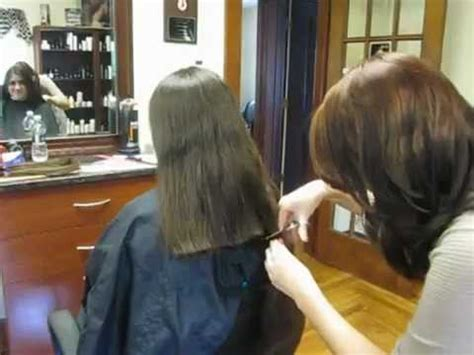 video on cutting long hair into a short shag doing it yourself she cut off all her long hair to donate youtube