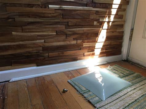 carpentry closing severe gap along baseboard and floors