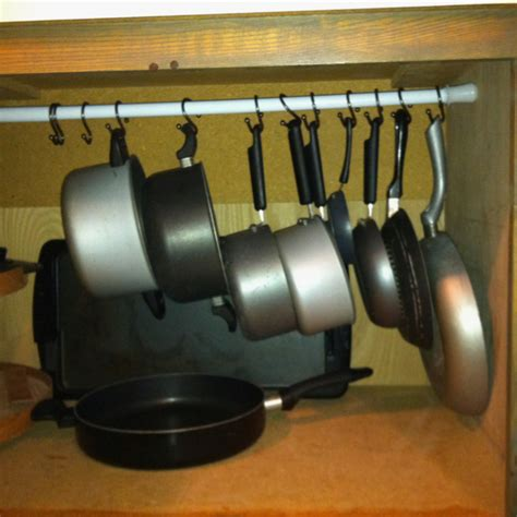 organize pots and pans 7 ways to organize your home using shower curtain hooks the frugal