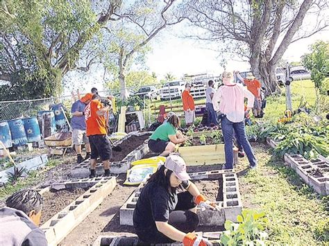 town s community garden gets help from home depot miami