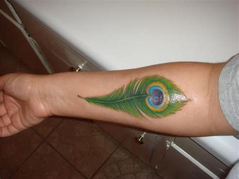 peacock feather tattoo hand peacock feather tattoos designs ideas and meaning