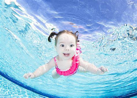 designboom underwater seth casteel snaps underwater babies taking a dive for the
