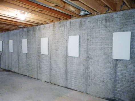 basement wall repairing straightening tilting foundation walls by