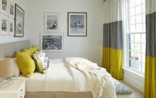 Gray and yellow bedroom with vintage black and white photograph on the