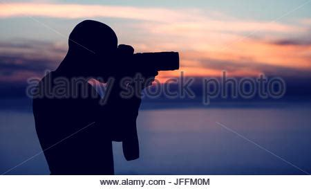 photographer taking photo of wildlife, man with camera and