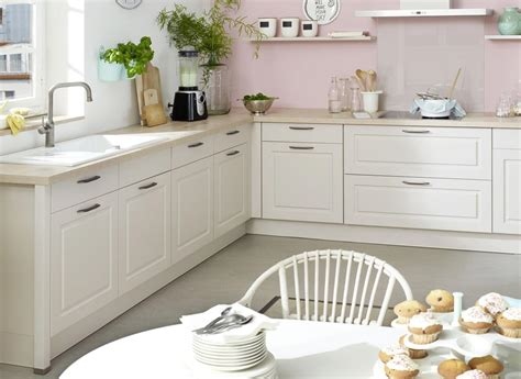 Photo of white kitchen cabinets that have a solid wood frame