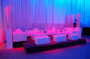 white lounge furniture provided seating in the artifacts room used for the cocktail reception