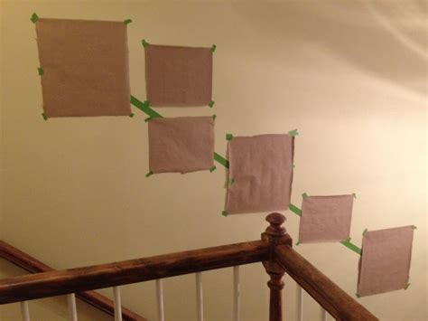 hang pictures on wall how to hang a photo gallery along a staircase something