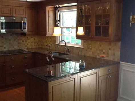 Paradiso Gold Granite With White Cabinetry