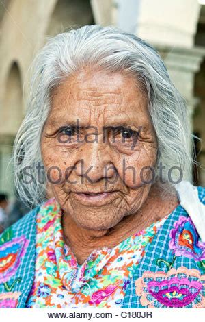 old mexican women face pics old mexican woman in colorful attire walking with a cane