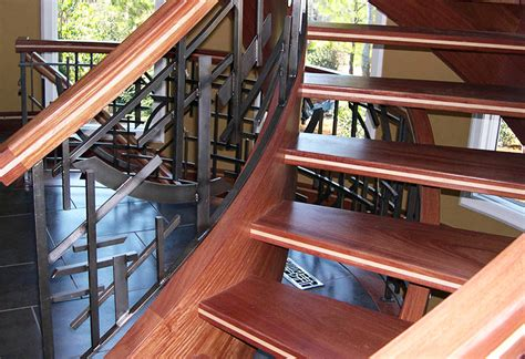Wrought Iron And Wood Banisters Open Riser Stairs Are Gaining Popularity Artistic Us