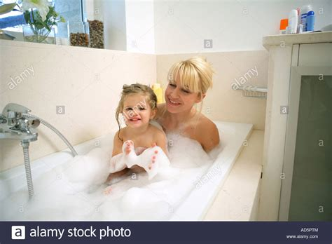 bathroom mother mother and child taking a bath stock photo royalty free