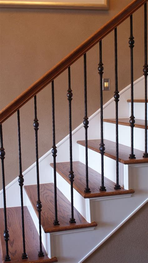 iron banister spindles at the stella journey home we removed the carpet on the
