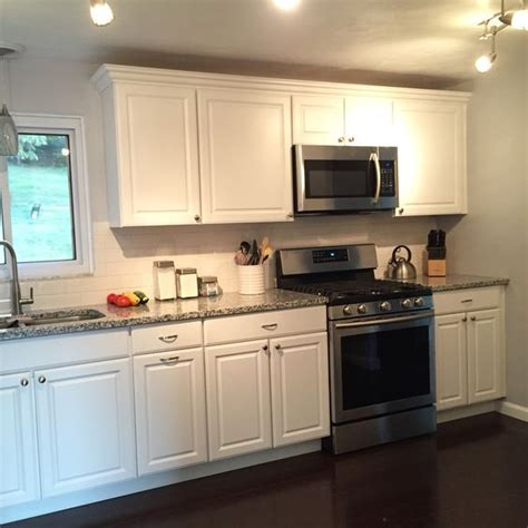 pearl granite with white cabinets loving our white cabinets pearl granite countertops