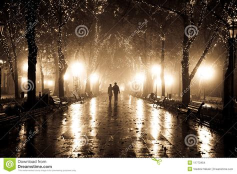 light for walking at night couple walking at alley in night lights stock images