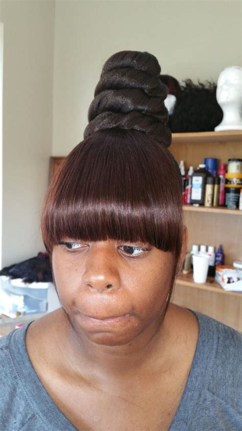 black lady bun with bangs bang and ponytail hairstyle fade haircut