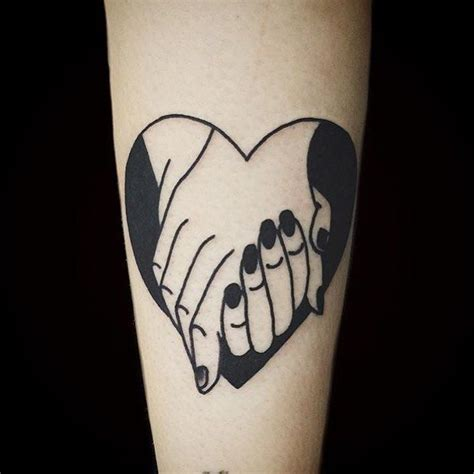 tattoo inspiration hand black hands holding tattoo tattoo inspiration