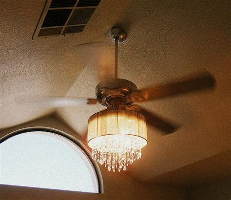 Ceiling Fan And Chandelier Addicted To House Redressing And Other Musings Why Not A Chandelier And A Fan Together It