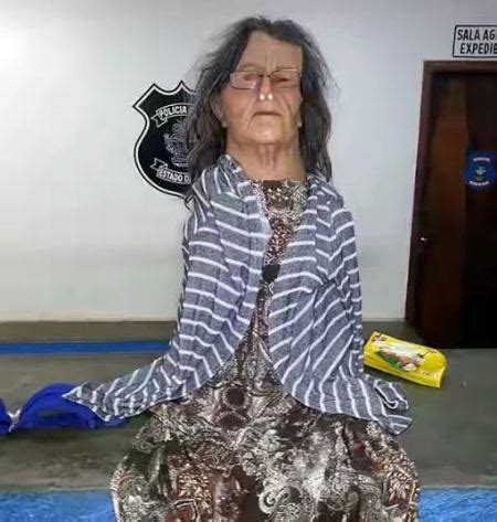 prisoner's bid to escape dressed as old woman foiled..(photos)