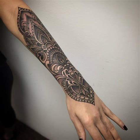 black and grey ornamental forearm by laura jade tattoos