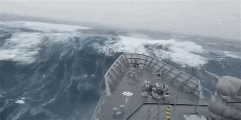 big boat gif watch this navy ship take on a truly gigantic wave