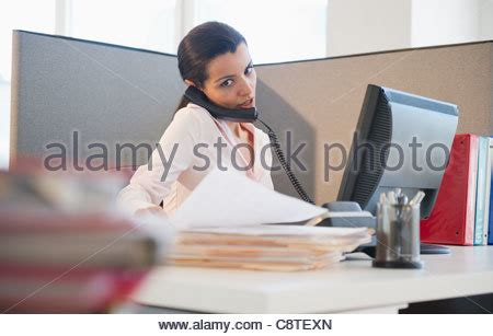 jersey city rec desk busy business woman multitasking in the office with four