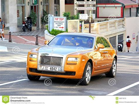 roll royce orange rolls royce ghost editorial image image 49874510