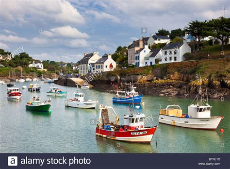 buy a boat france small fishing boats in the harbour at doelan village