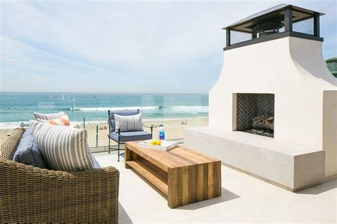 perfect seaside deck features seaside patio  wicker