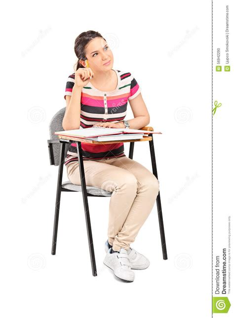 Pensive Female Student Sitting On A School Desk Stock Picture Of Student Sitting At Desk