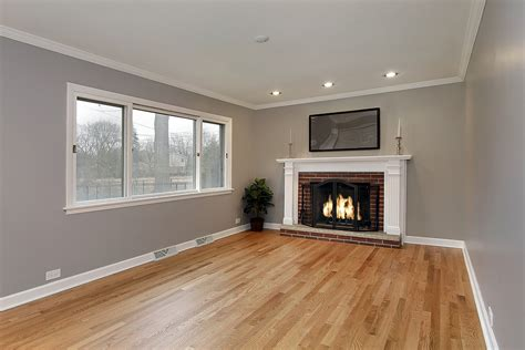 family room in remodeled home with brick fireplace living