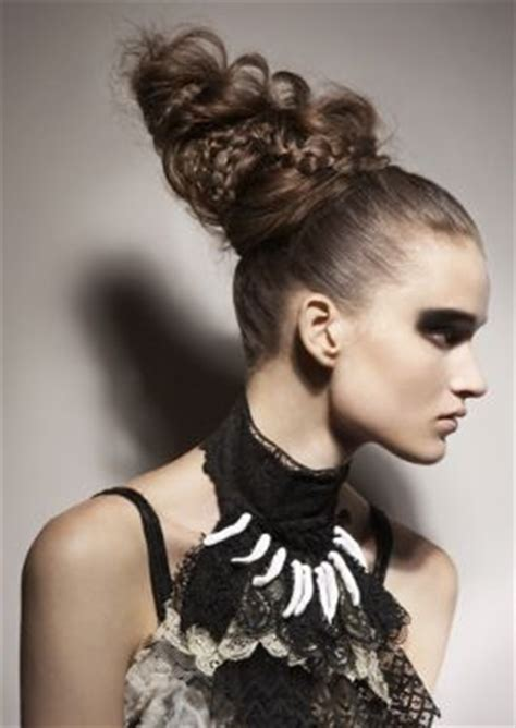 fashion forward hair up do women a very long and very high updo her hair is straight