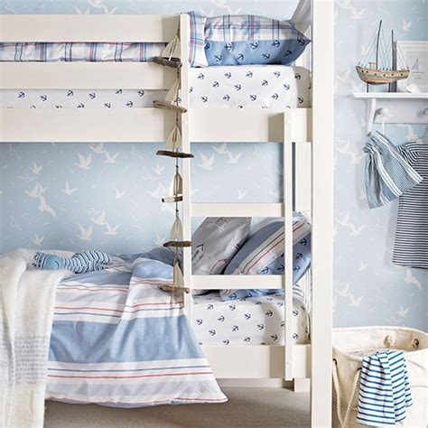 blue coastal style boys room with bunk beds children s