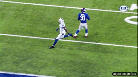 Reggie wayne turns almost interception into touchdown with amazing