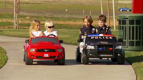 for kids police vs power wheels race police charger vs mustang youtube