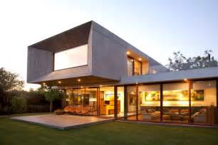 House with glass lower floor and concrete upper modern house designs
