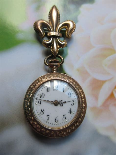 antique pocket tlc pin from