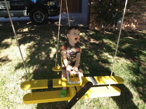 swinging neighbours yellow biplane swing for neighbor kids hang on snoopy