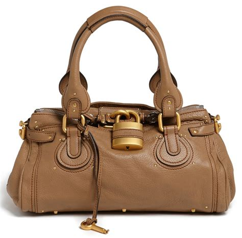Is It A Bag Is It A Purse Its Topshops Raffia Crossbody Handbag by The It Bag A Historical Handbag Timeline Purseblog