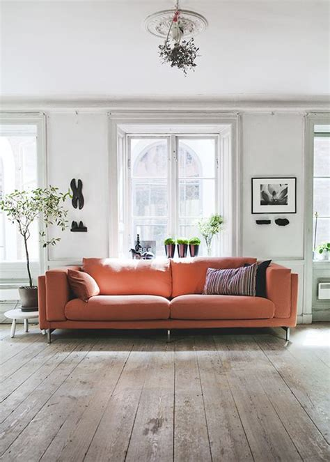 orange couch living room ideas coral couch via my unfinished home my ideal home