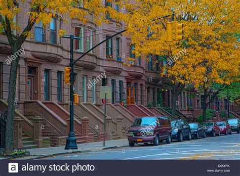 buying house in new york harlem row houses in autumn new york city new york usa stock photo royalty free