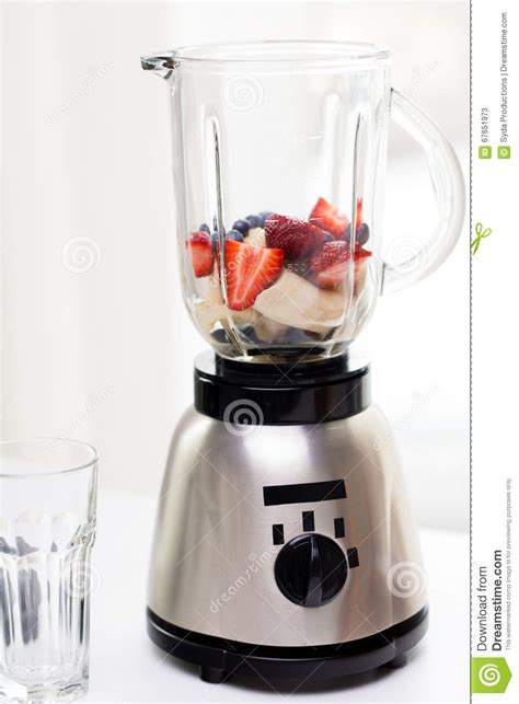 healthy kitchen appliances close up of blender shaker with fruits and berries stock