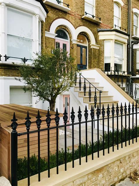 elegant front garden design bullnose steps metal rails