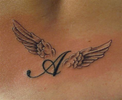 tattoo lettering with angel wings amen tattoo alessandra meneghello tattoo artist