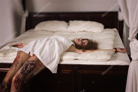 dead in bed dead woman lying on the bed stock photo 83668674
