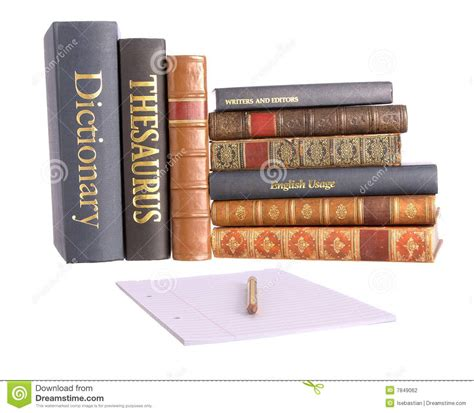 reference to books in paper row of reference books with paper and pencil stock